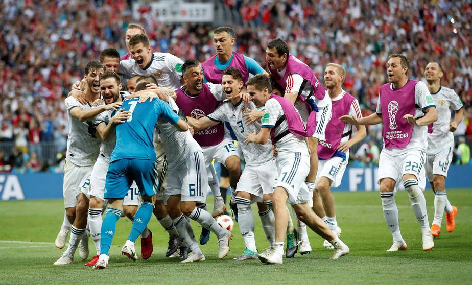 Soccer Football - World Cup - Round of 16 - Spain vs Russia - Luzhniki Stadium, Moscow, Russia - July 1, 2018  Russia players celebrate winning the penalty shootout   REUTERS/Carl Recine