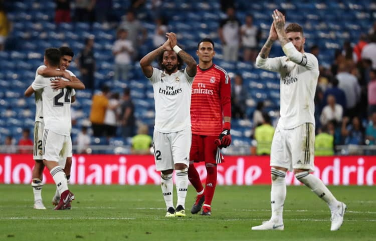 Soccer Football - La Liga Santander - Real Madrid vs Getafe - Santiago Bernabeu, Madrid, Spain - August 19, 2018   Real Madrid's Marcelo and Sergio Ramos applaud the fans after the match   REUTERS/Sergio Perez