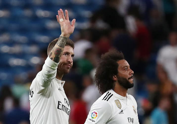 Soccer Football - La Liga Santander - Real Madrid vs Getafe - Santiago Bernabeu, Madrid, Spain - August 19, 2018   Real Madrid's Sergio Ramos and Marcelo applaud the fans after the match   REUTERS/Sergio Perez