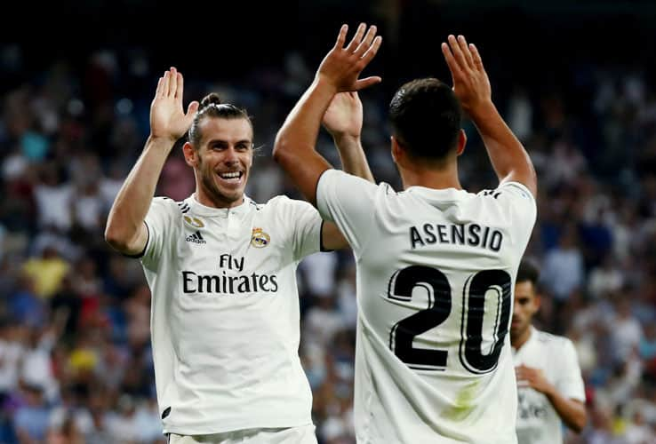Soccer Football - La Liga Santander - Real Madrid vs Getafe - Santiago Bernabeu, Madrid, Spain - August 19, 2018   Real Madrid's Gareth Bale celebrates scoring their second goal with Marco Asensio    REUTERS/Sergio Perez      TPX IMAGES OF THE DAY