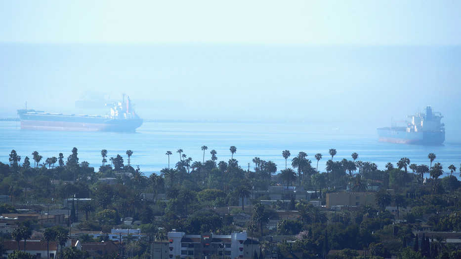 An oil tanker and a container ship sit off shore of the port of the Long Beach during the outbreak of the coronavirus disease (COVID-19) in Long Beach, California, U.S., April 23, 2020. RE