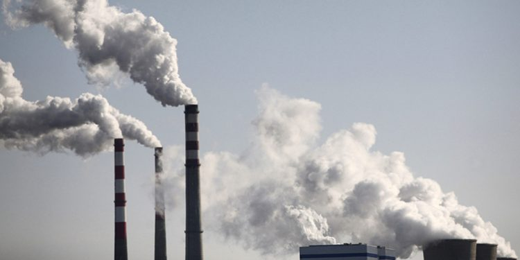 """Smoke billows from a power plant in Wuzhong, of the Ningxia Hui Autonomous Region, November 18, 2009. China said on Thursday that its promise to cut carbon intensity up to 45 percent by 2020 is a """"binding goal"""", and that it will use strengthened policies including taxation and financial measures to reach the target. Picture taken November 18, 2009. REUTERS/Stringer (CHINA ENVIRONMENT ENERGY) CHINA OUT. NO COMMERCIAL OR EDITORIAL SALES IN CHINA CLIMATE-COPENHAGEN/"""